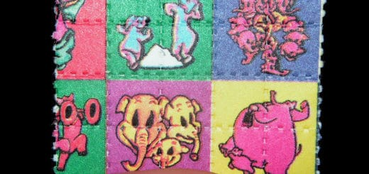 1024px-Pink_Elephants_on_Parade_Blotter_LSD_Dumbo.jpg