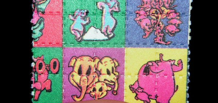 640px-Pink_Elephants_on_Parade_Blotter_LSD_Dumbo.jpg