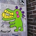 Street Art à Amsterdam : Stickers, collages et graffitis
