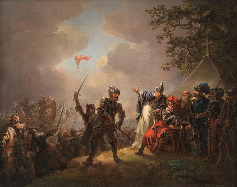 Apparition du drapeau danois lors de la bataille de Lyndanisse, entre le roi Valdemar le Victorieux et les Estoniens, le 15 juin 1219.