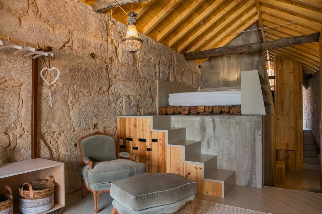 Chambre design et chaleureuses de l'hôtel de charme : Armazém Luxury Housing à Porto.
