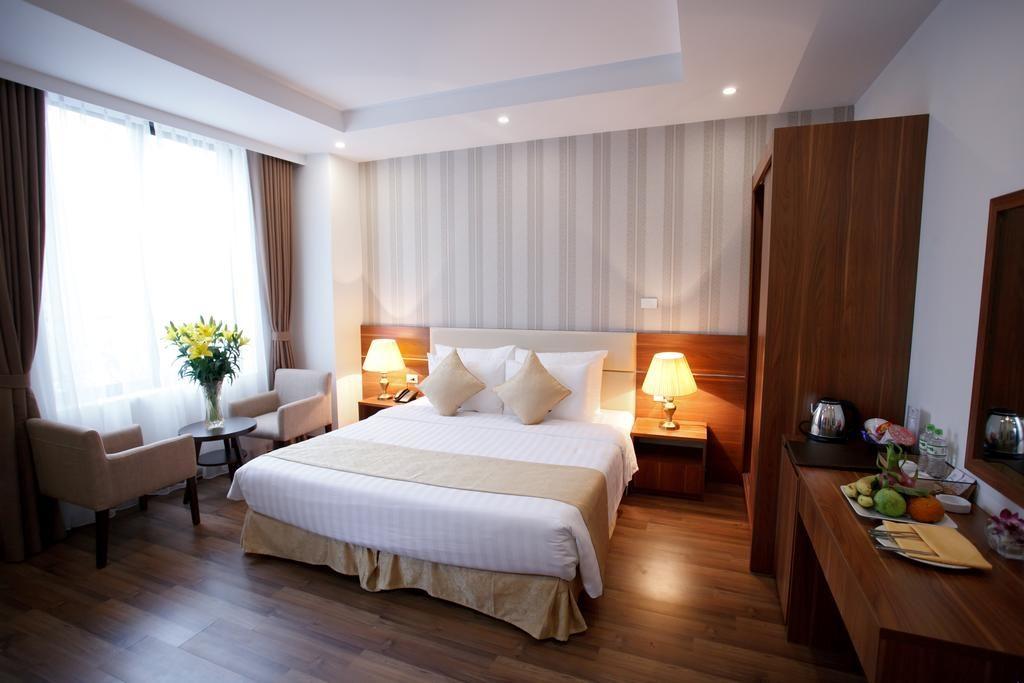 Chambres dans un style moderne et sobre au Hanoi Pomihoa Hotel.