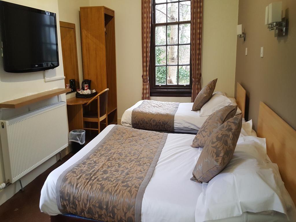 Chambre simple de la maison d'hôtes McLays Guest House à Glasgow.