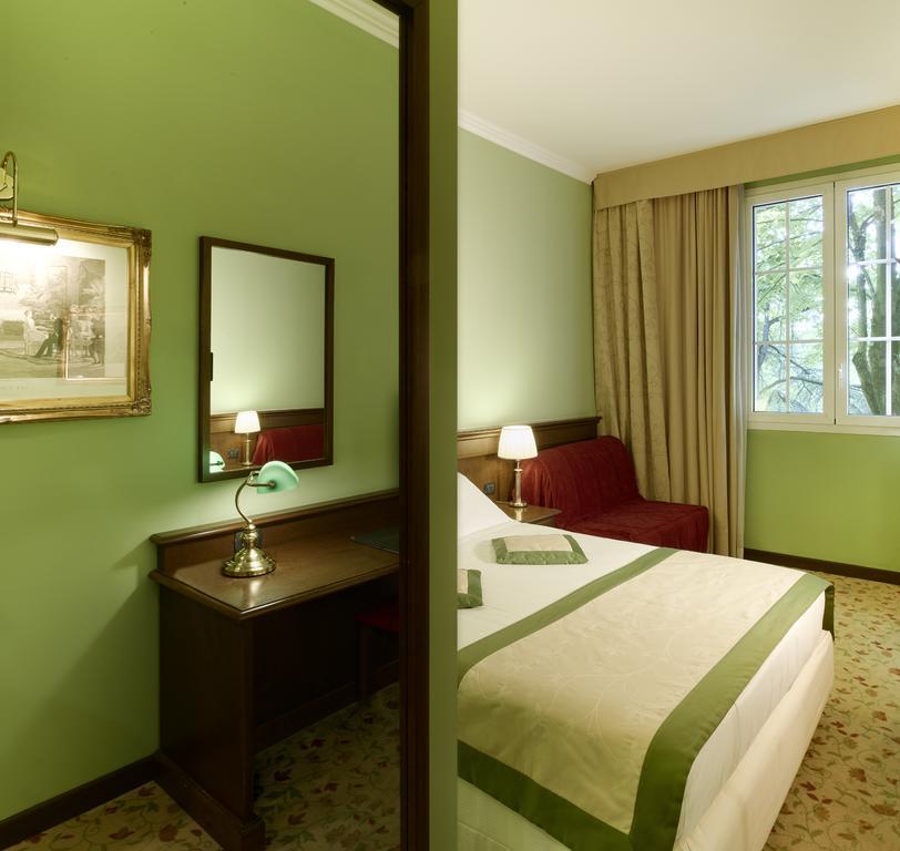Agréable chambre de l'hôtel Meditur Hotel Bologna à Bologne.