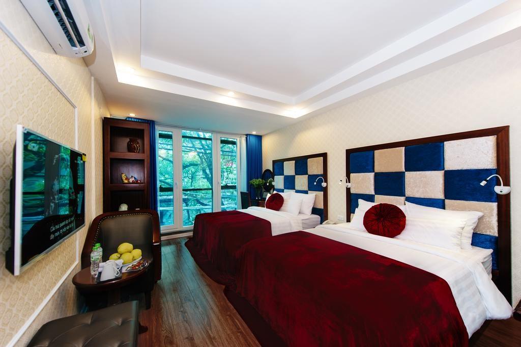 Agréable chambre de l'Olympus Old Quarter Hotel à Hanoi.