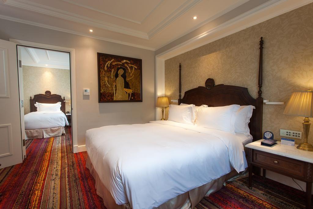 >Chambre élégante au The Lapis Hotel à Hanoi.