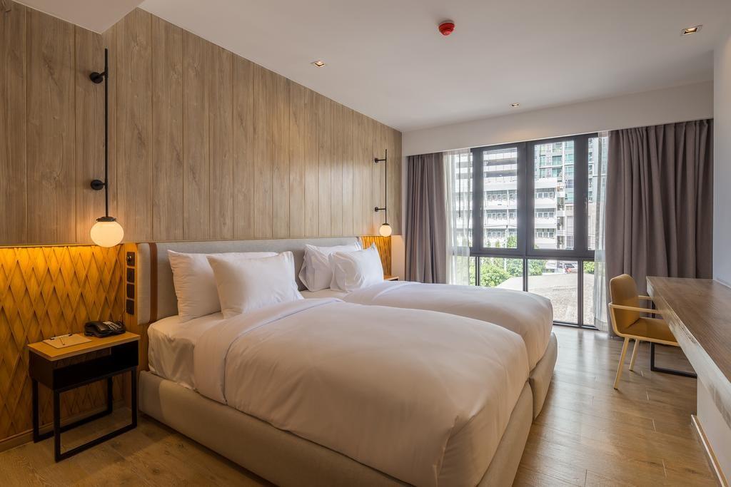 Calme, confort et minimaliste chaud à l'hôtel Craftsman Bangkok.